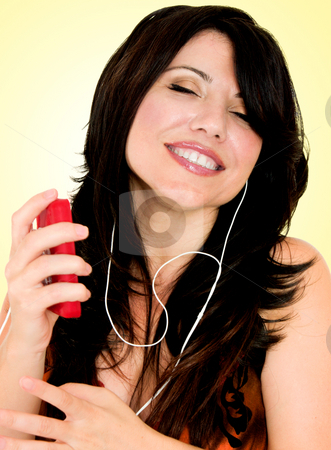 Brunette with electronic mp3 player stock photo, A woman listens to music by Leah-Anne Thompson