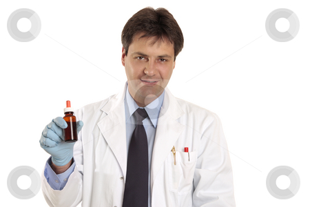 Doctor or vet with medication stock photo, A doctor or vet holding, showing,  or promoting a medicine, herbal remedy or ointment. by Leah-Anne Thompson