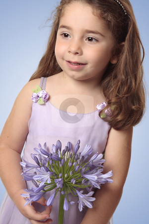 Sweet girl with lily flower stock photo, Sweet pretty young girl holding a large agapanthus liily flower. by Leah-Anne Thompson
