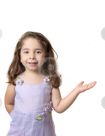 Beautiful smiling girl with one hand outstretched stock photo, Beautiful smiling girl standing with one hand outstretched. with copyspace. by Leah-Anne Thompson