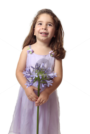 Pretty girl with beautiful flower smiling stock photo, Smiling girl looking up holding a purple agapanthus flower.  Space for your copy. by Leah-Anne Thompson
