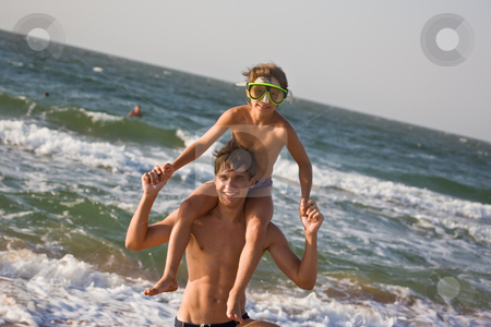 Summer fun stock photo, People series: two brother on the sea getting fun by Gennady Kravetsky
