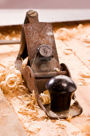 Old plane stock photo, Old plane on wooden table with shavings by Gennady Kravetsky