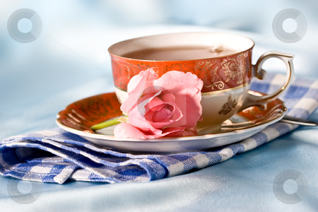 romantic still life stock photo, Cup of tea with flower over azure by Gennady Kravetsky