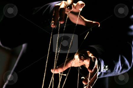 Puppeteer stock photo, Conceptual series: hands of puppeteer with rope by Gennady Kravetsky