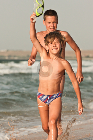 Fast run stock photo, People series: two brother are play the game on sea beach by Gennady Kravetsky
