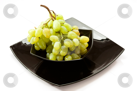 Grapes stock photo, Food series: black plate with green grapes by Gennady Kravetsky