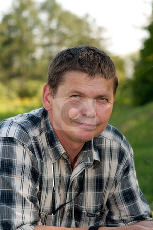 Man stock photo, People series: Portarit of smiling man on natnature by Gennady Kravetsky