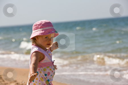 Little girl stock photo, People series: little funny girl on the sea beach by Gennady Kravetsky