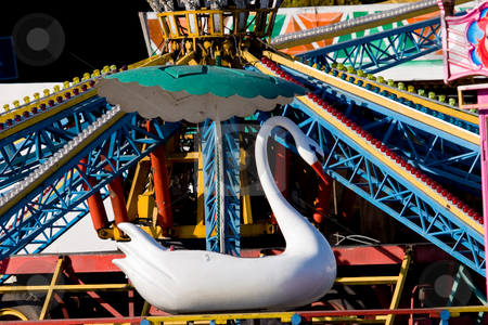 Roundabout stock photo, Entertainment series: empty child's roundabout with white swen by Gennady Kravetsky