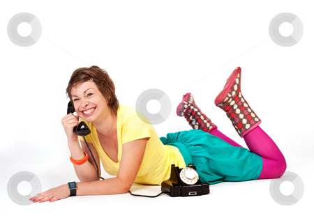 Talker girl stock photo, People series: young girl in bright clothes speak on phone by Gennady Kravetsky