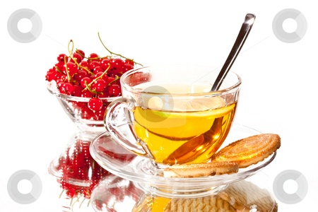 Tea stock photo, Drink series: glass cup of tea with red currants by Gennady Kravetsky