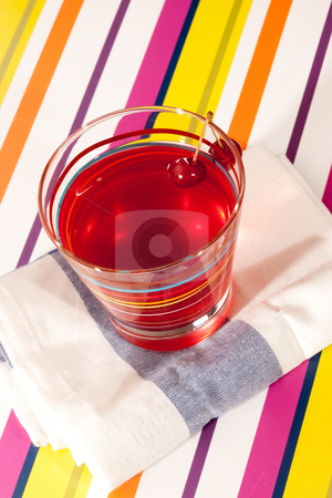 Cherry drink stock photo, Drink series: glass of cherry beverage on the napkin by Gennady Kravetsky