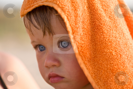 Little girle stock photo, People series: portrait of little girl in orange towel by Gennady Kravetsky