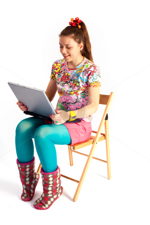 Notebook girl stock photo, People series: young woman with notebook on chair by Gennady Kravetsky