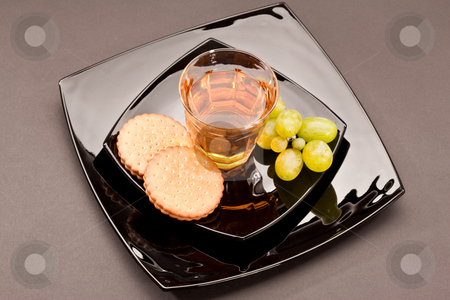 Grape juice stock photo, Food series: black plate with glass of grape and pastry by Gennady Kravetsky