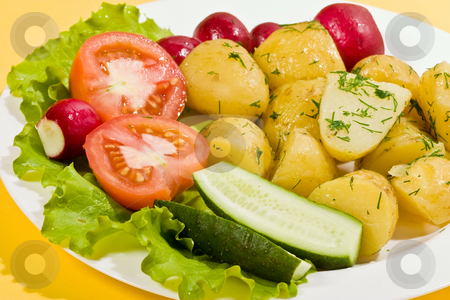 Boiled potatoes stock photo, Food series: tasty boiled potatoes with tomato, radish and lettuce by Gennady Kravetsky