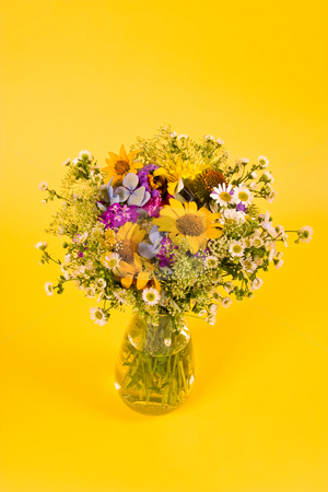 Bunch of flowers  stock photo, Bunch of various flowers on the yellow background by Gennady Kravetsky