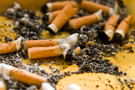 smoke time stock photo, Ashes and two cigarette stub in the ash tray by Gennady Kravetsky