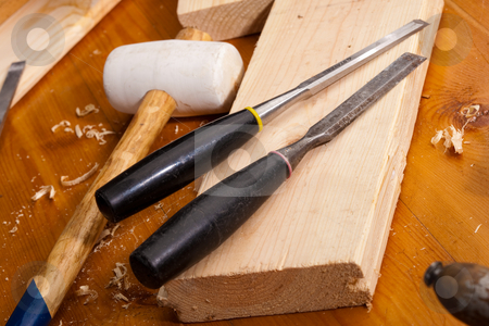 Chisel stock photo, Tools series: steel chisel on wooden plank with shaving by Gennady Kravetsky