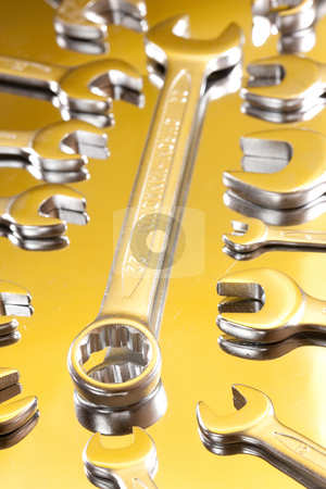 Bolt and wrench stock photo, Tools series: ring spanner and wrench on reflectife metal surface by Gennady Kravetsky