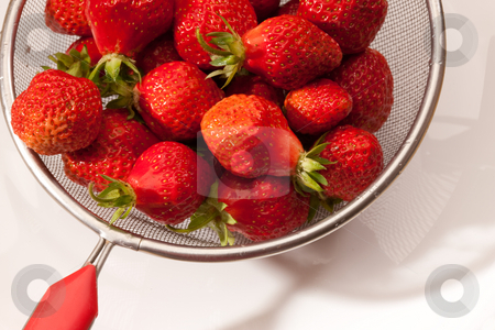 Strawberry stock photo, Food series: red straberries in steel collander by Gennady Kravetsky