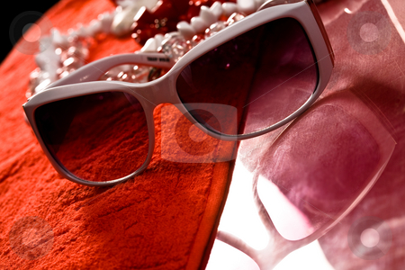 Sun glasses stock photo, Fashion series: white sun glasses on the red towel by Gennady Kravetsky