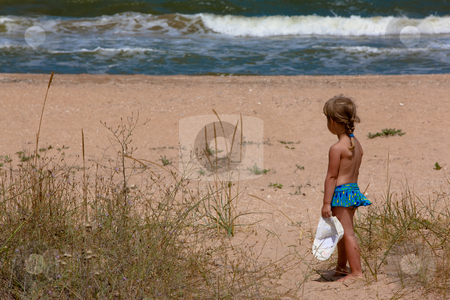 Girl and sea stock photo, People series: summer little girl on the beach by Gennady Kravetsky