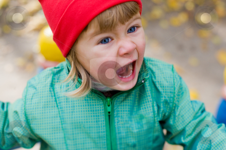 Red cap girl stock photo, Portrait of the little girl on red cap by Gennady Kravetsky