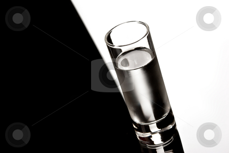 Vodka stock photo, Drink series: glass of Russian vodka over black by Gennady Kravetsky