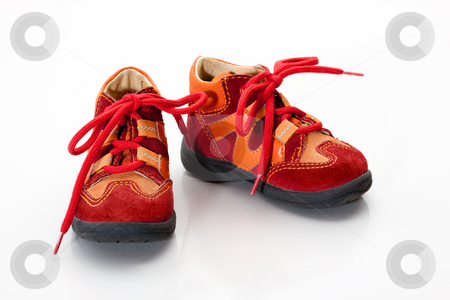 Shoes stock photo, Childs red shoes over white by Gennady Kravetsky