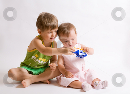 Play stock photo, People series: affectionate brother and little sister play by Gennady Kravetsky