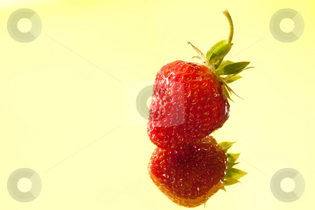 Strawberry stock photo, Food series: red strawberry on the yellow background by Gennady Kravetsky