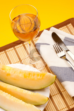 Melon and wine stock photo, Food series: sliced melon and glass of wine by Gennady Kravetsky