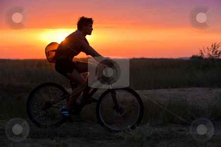 Summer cyclist stock photo, People series: summer cyclist on the subset light by Gennady Kravetsky