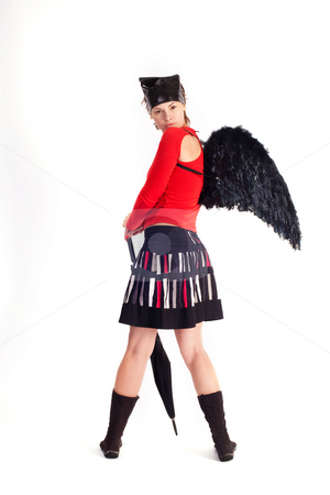 Girl is imp stock photo, People series: young girl with black umbrella and wing by Gennady Kravetsky