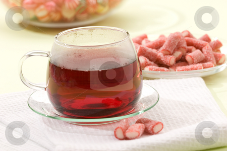 Tea stock photo, Drink series: cup of hot tea with candy by Gennady Kravetsky