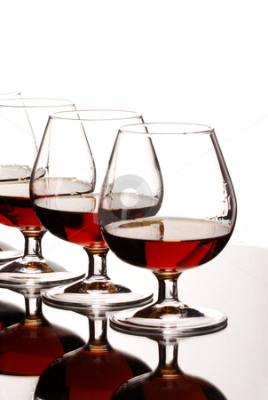 Glasses of cognac  stock photo, Drink series: some glasses of strong cognac by Gennady Kravetsky