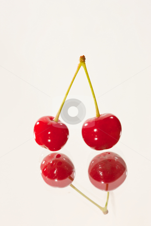 Cherry stock photo, Food series: two cherries on reflective sutface by Gennady Kravetsky