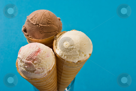 Ice cream stock photo, Food series: chocolate ice cream and vanilla over blue by Gennady Kravetsky