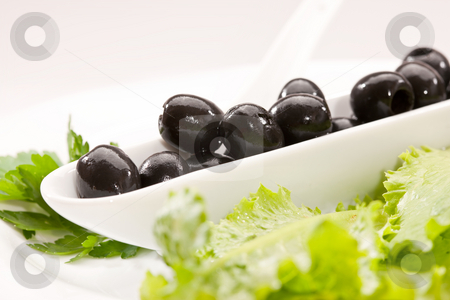Olive stock photo, Food series: macro picture of plate with black olive by Gennady Kravetsky