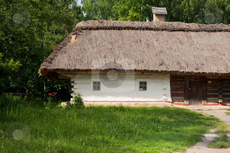 Ukrainian hut stock photo, Old traditional ukrainian house with thatched roof by Gennady Kravetsky