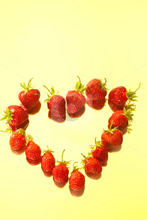 Berry heart stock photo, Food series: red strawberry on the yellow background by Gennady Kravetsky