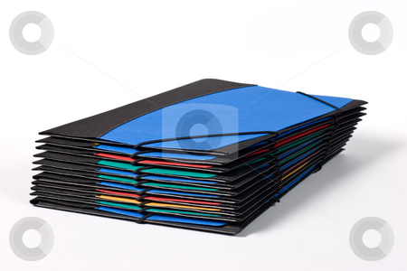 Office folders stock photo, Object series: pile of assorted folders over white by Gennady Kravetsky
