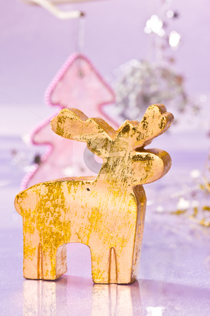 Golden deer stock photo, Holiday series: christmas golden deer with decorated fir by Gennady Kravetsky
