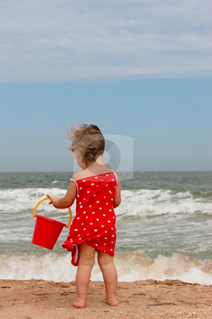 Play stock photo, People series: little girl play with sand by Gennady Kravetsky