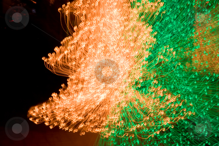 Christmas lights stock photo, Christmas lights in the city on the move, abstract background by Gennady Kravetsky