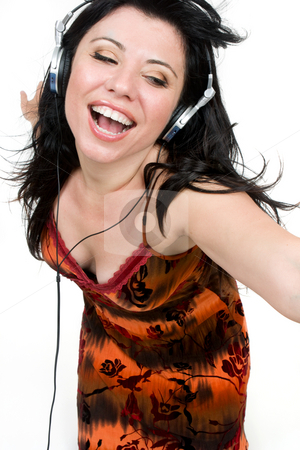 Feel the music stock photo, A spirited girl dances to music by Leah-Anne Thompson