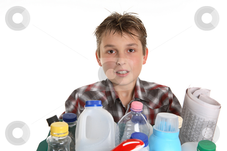 Boy with recycling stock photo, Boy holding a selection of recycling objects. by Leah-Anne Thompson