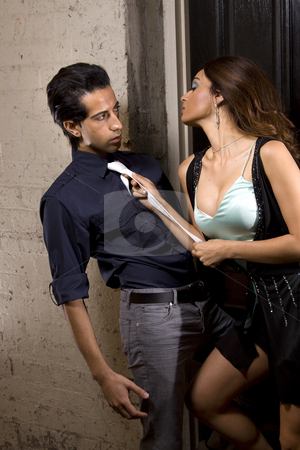 Woman seducing a man in a back alley stock photo,  by Jandrie Lombard